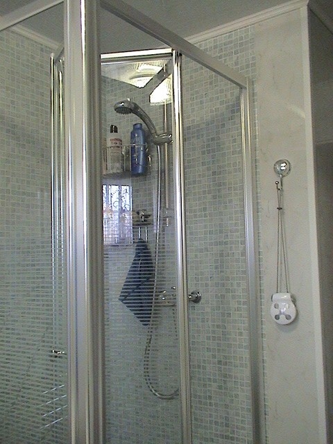 folding shower door in polished silver