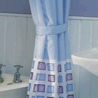 shower over the bath with a shower curtain